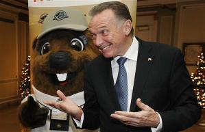 Peter Kent, Canada's Minister of the Environment, plays hardball with a beaver