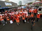 The Global Day of Action March winds through the streets of Durban.