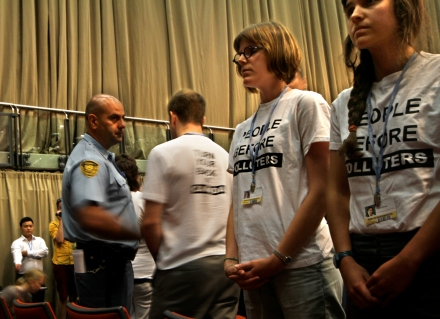 Members of the CYD are escorted away UN securty after turning their backs on Canada as Peter Kent addressed plenary at COP 17.